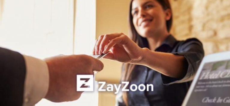 a woman hands a man a credit card