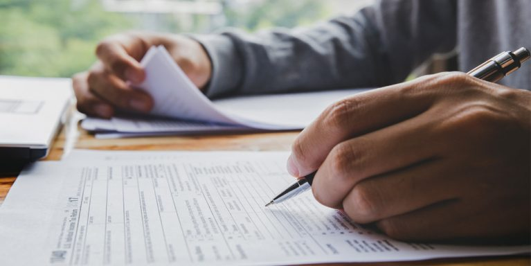 A person fills out tax documents