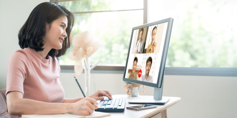 A female Asian recruitment candidate engaging in a virtual group interview