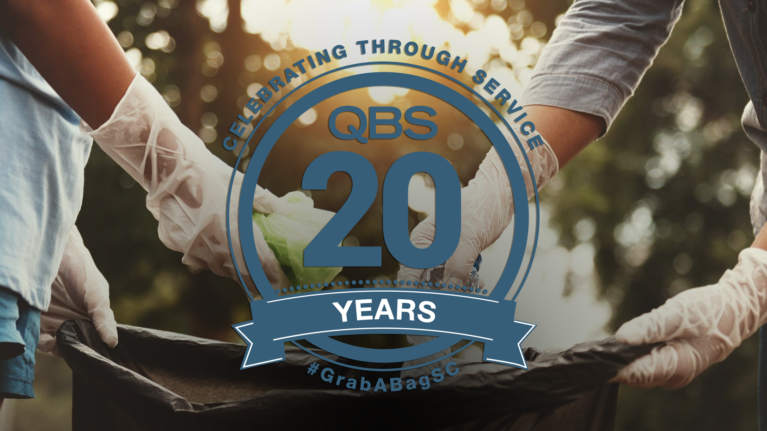 people picking up litter with the QBS 20 Years Logo